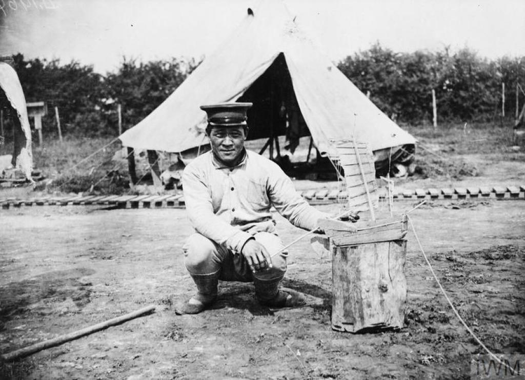 A Chinese worker with a model junk at the Chinese Labour Corps Camp at Caestre, 14 July 1917'