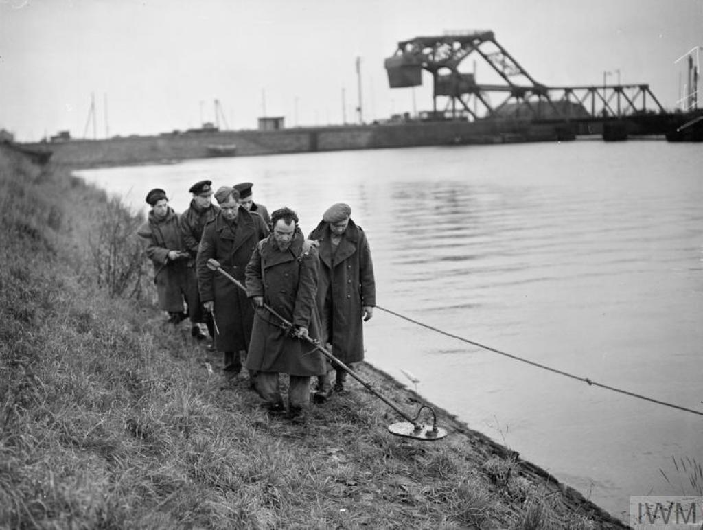 Men making a path through landmines in Antwerp, Belgium