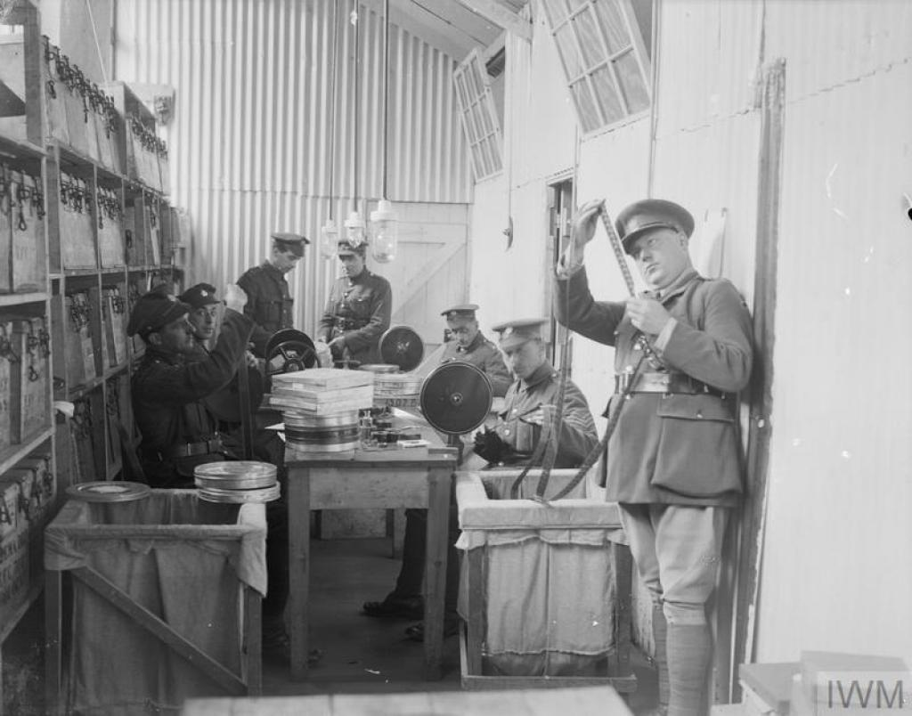 Image: Soldiers of the Army Service Corps preparing films for use in behind-the-lines cinemas for the troops. Boulogne, 5 June 1918 © IWM (Q 8885)