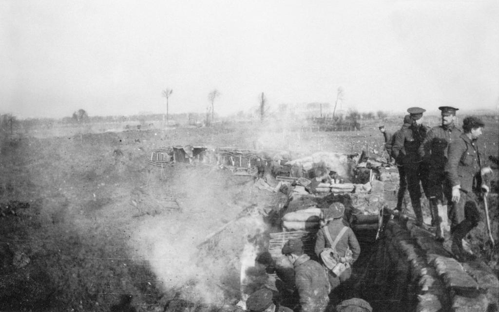 Members of the 1 Buffs on a trench parapet, December 1914