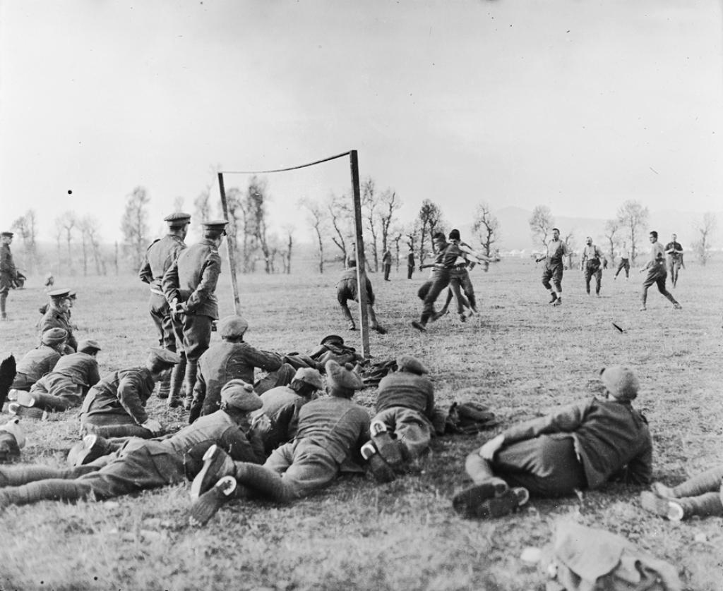 Image: Officers versus other ranks football match played by members of the 26th Divisional Ammunition Train, ASC near their camp, just outside the city of Salonika, Christmas Day 1915. © IWM (Q 31574)