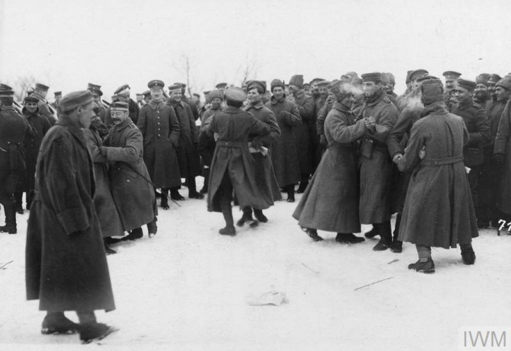German and Bolshevik soldiers dancing with each other in the area of the Yaselda River at the time of the peace negotiations at Brest-Litovsk, February 1918. © IWM (Q 86975)