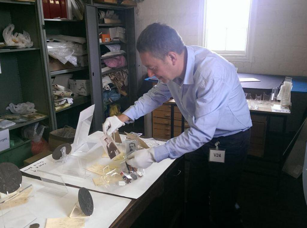 Dr Brad Beaven working on the 'Lest We Forget' exhibition.