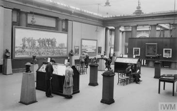 Visitors to one of the Imperial War Museum's art galleries at Crystal Palace in May 1921. © IWM (Q 17028)